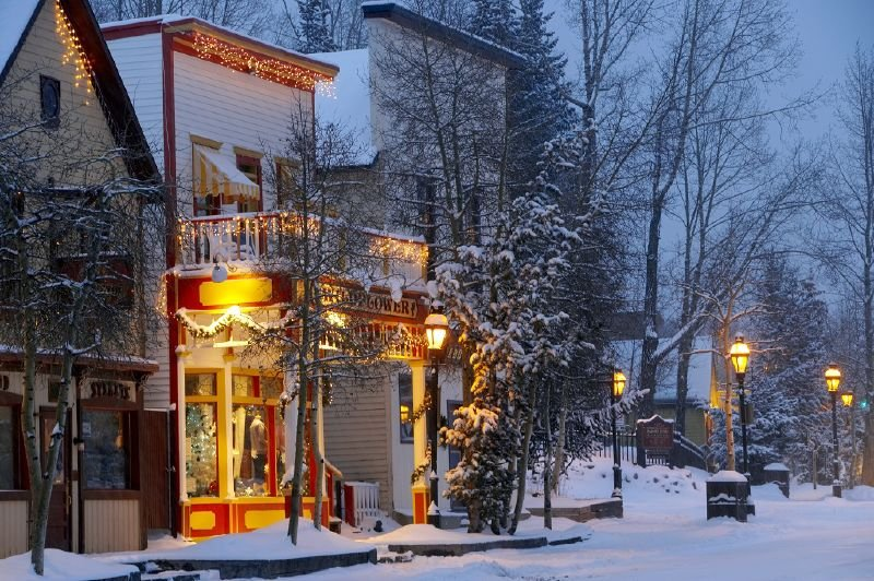 A shop in Breckenridge, Colorado remains lit up in evening