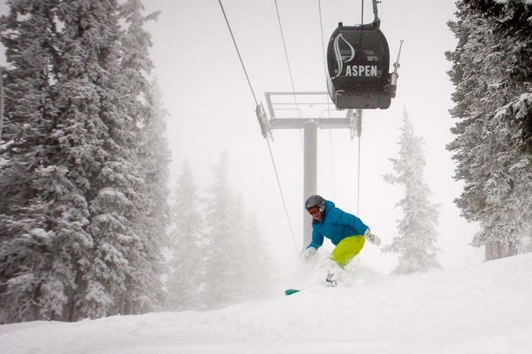 Snowboarder in powder at Aspen, Colorado