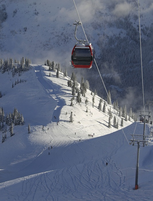 Skiers ride under the Crystal Mountain Gondola in Washington.