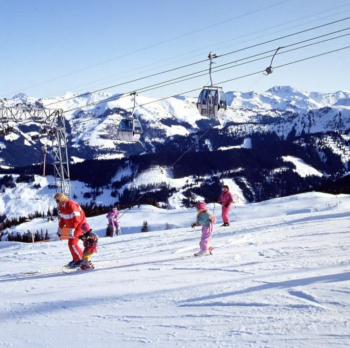 A family skiing in Wildschoenau, AUT.