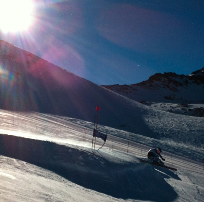 Ganong's alpine teammate, Andrew Weibrecht, whizzes past a gate with the Chilean sun at his back. Photo by Daron Rahlves.