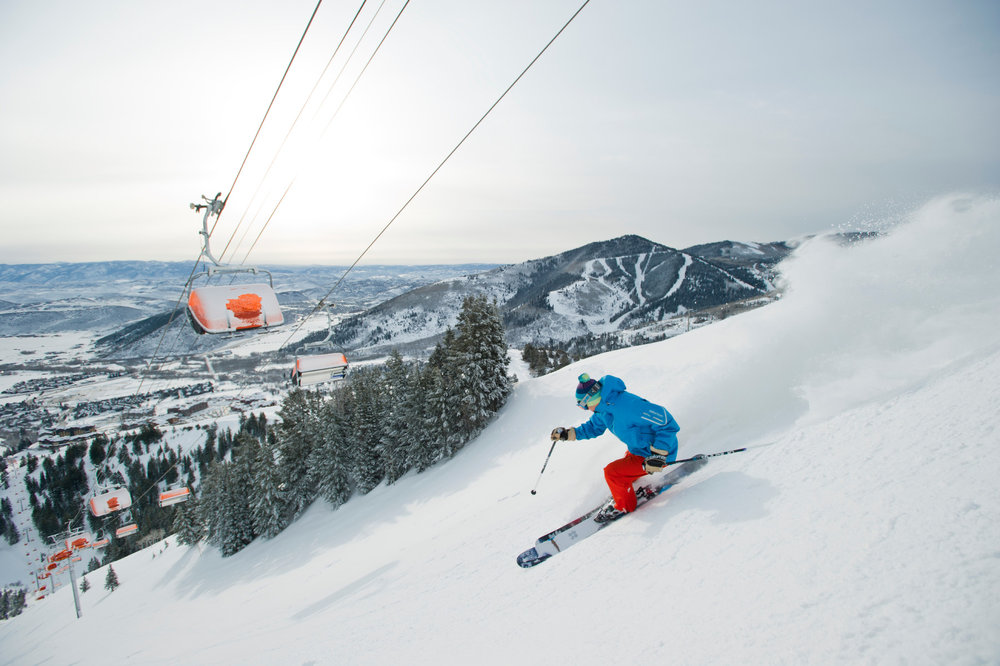 Powder skiing under Canyons Resort's heated Orange Bubble lift