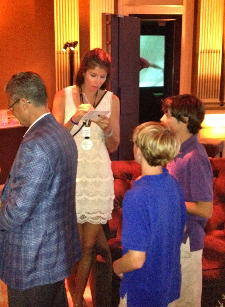 Signing autographs for her young fans is just part of the job for Olenick. Photo by Jessica Miller.