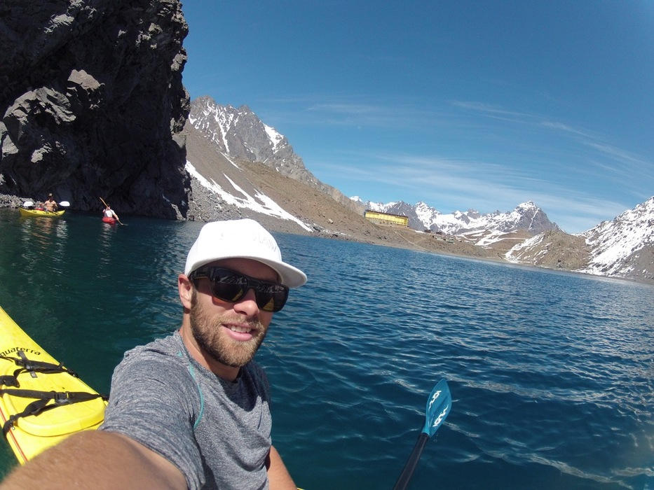 Travis out kayaking on Inca Lake with the Portillo Hotel in the background