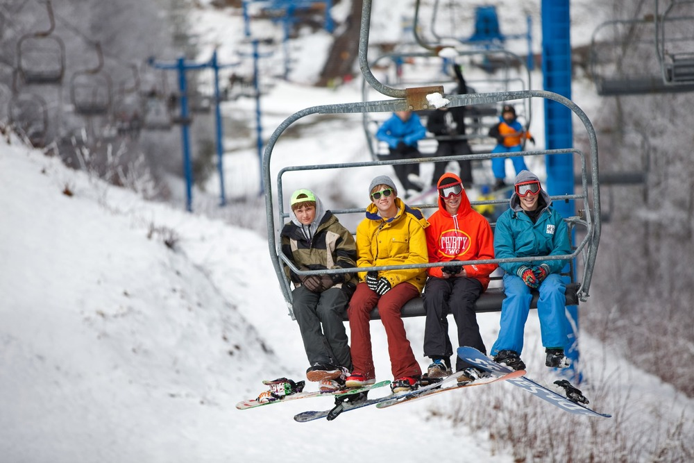 A crew of snowboarders makes another lap up the chairlift. Photo Courtesy of Catalooche Ski Area.