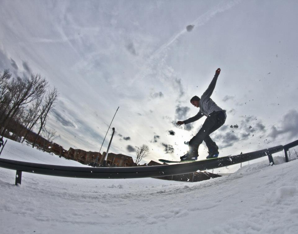 A boarder slides on down rail at Seven Springs terrain park. Photo Courtesy of Seven Springs.