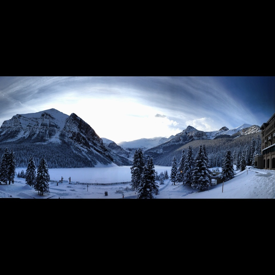 A panoramic shot from Le Chateau Lake Louise shows off the majestic charm of the lake and the mountains that surround it.
