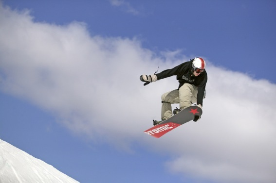 Snowboarder catches air at Crystal Mountain, MI.