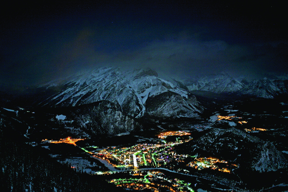 The lights of Banff under the night sky. Photo courtesy of Ski Banff-Lake Louise-Sunshine.