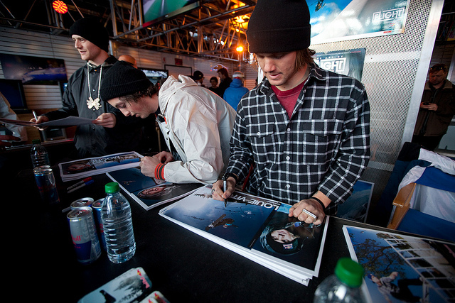 Louie Vito signing posters in the Red Bull tent.