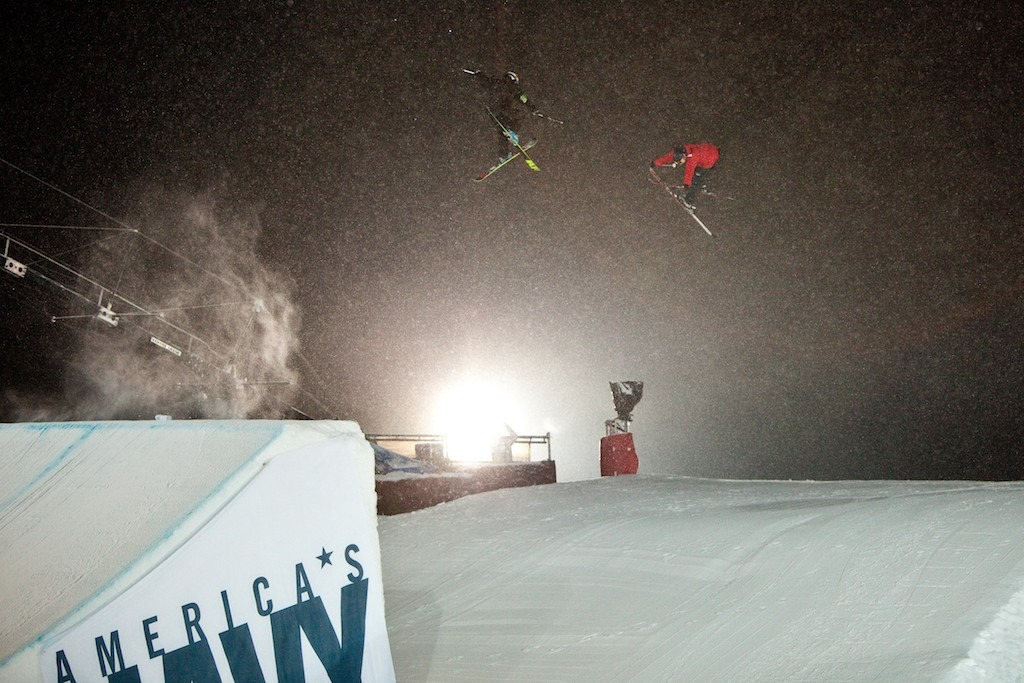 Getting the shot. A competitor is followed over the Big Air jump by a filmer with a GoPro. - ©Jeremy Swanson