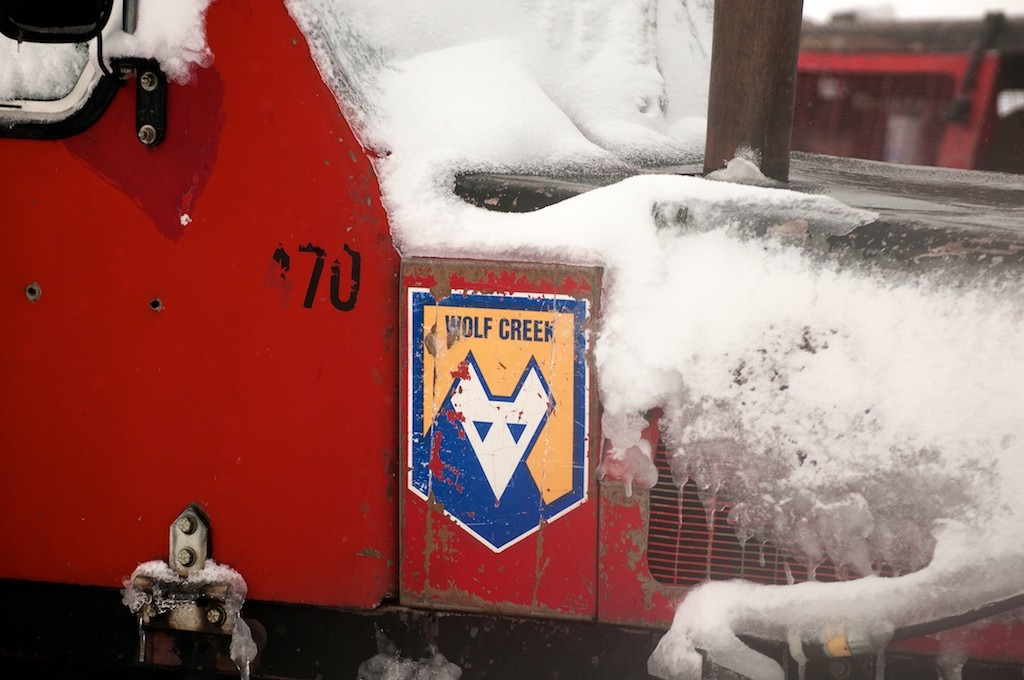 The Wolf Creek logo on an old snowcat.