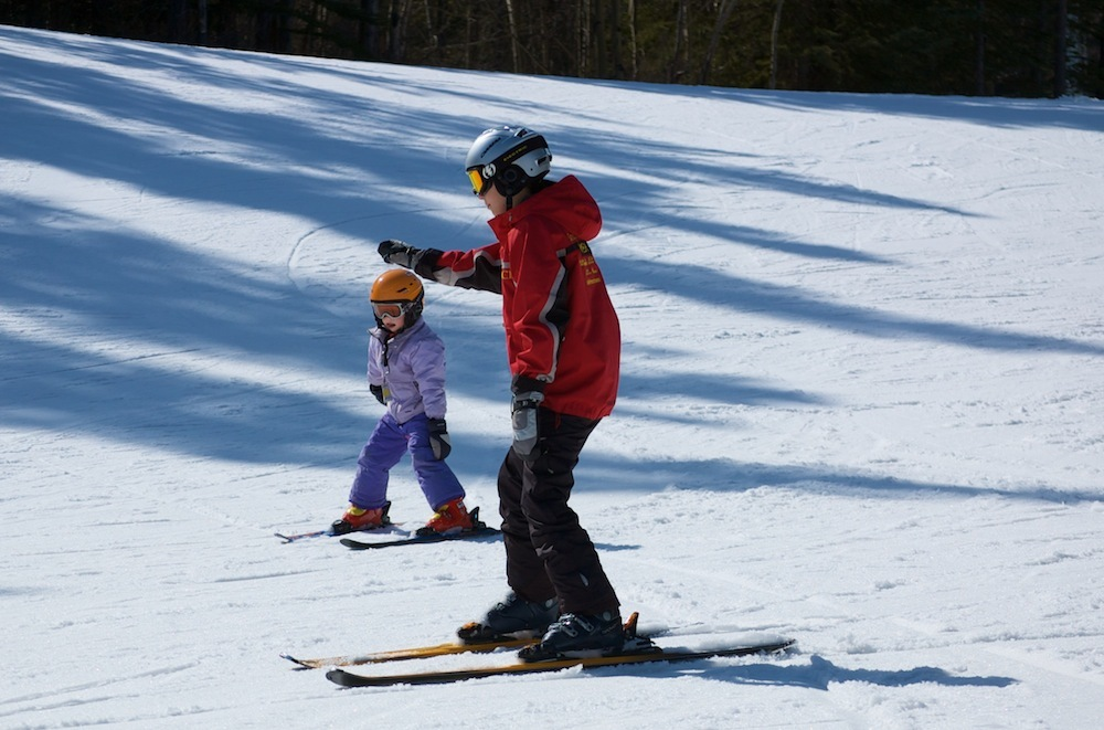 A child learns to ski at Nakiska ski area in Alberta. Photo courtesy of Resorts of the Canadian Rockies.