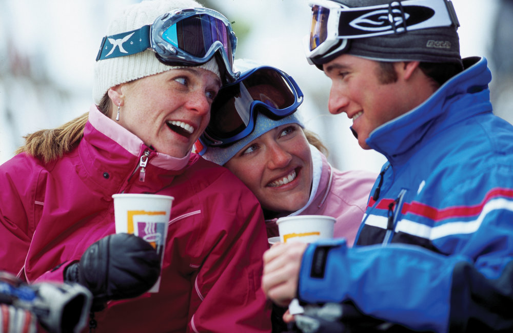 Mount Sunapee visitors enjoy some some laughs and hot drinks as they try to keep warm.