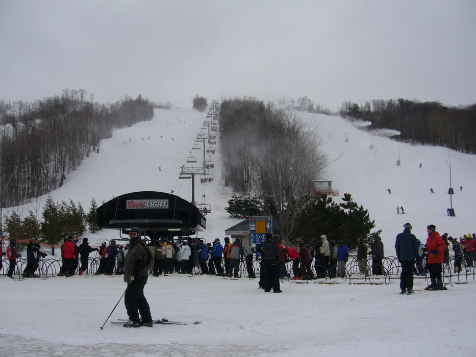 Skiers waiting for a lift at Blue Mountain, Ontario.