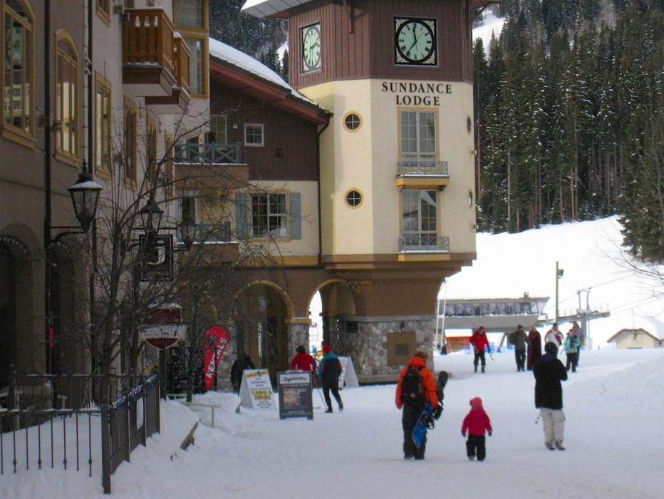 A family walks through the village at Sun Peaks. Photo by Becky Lomax. - ©Becky Lomax