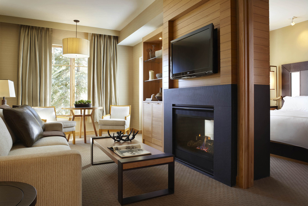 "The two-way gas fireplace features matching 42"" flat screen TVs above it in both the living room and the bedroom."