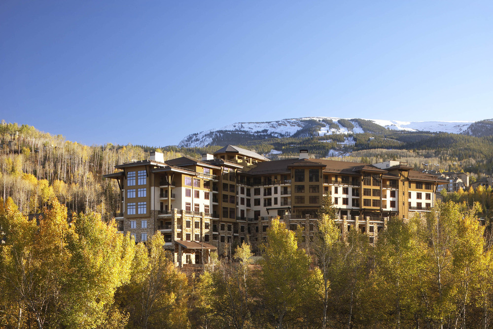 The stone and wood Viceroy Snowmass exterior naturally blends into the beauty of the ski resort behind it. 