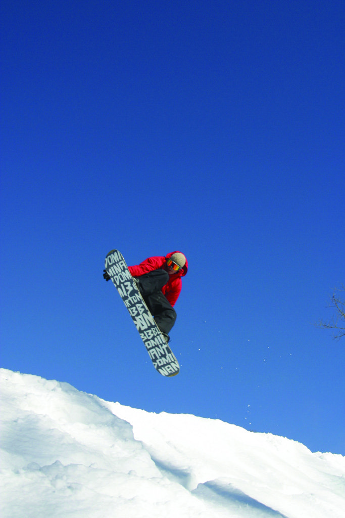 A snowboarder gets big air off a jump in Indianhead Mountain, Michigan
