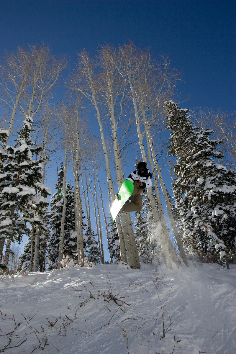 Snowboarders catch some air during Gnu, Guts & Glory freeride event at Canyons Resort, Mar. 16.