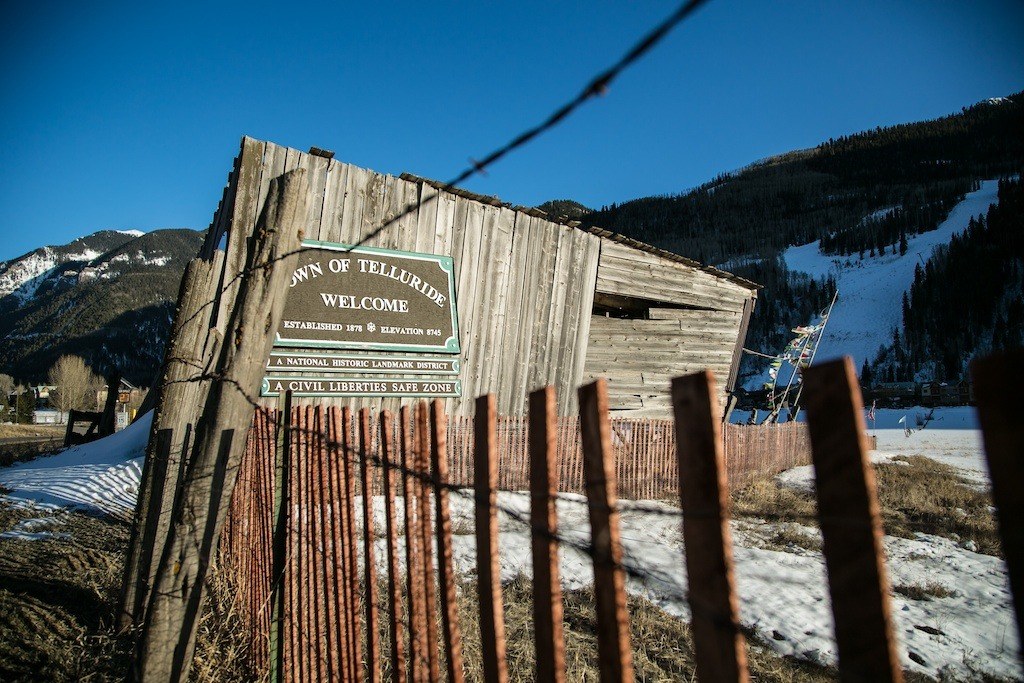 Prayer flags, barbed wire, and an old barn...welcome to Telluride. - ©Liam Doran