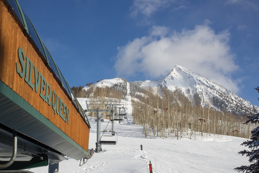 A view of the Silver Queen lift with Mount Crested Butte in the background at the base of Crested Butte Resort, Colorado.