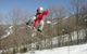 A snowboarder catches air in Jiminy Peak, Mass.