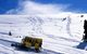 A snowcat makes its way up a mountain in Keystone, Colorado