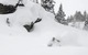 A skier is submerged in powder in Jackson Hole Wyoming