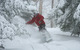 A snowboarder surfing through powder at Mt Snow, VT.