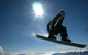 A snowboarder jumping at Flattach Mölltaler AUT