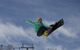 Gretchen Bleiler taking flight over Aspen, Colorado. Image courtesy Aspen Skiing Company.