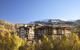 The stone and wood Viceroy Snowmass exterior naturally blends into the beauty of the ski resort behind it.  - ©Viceroy Snowmass