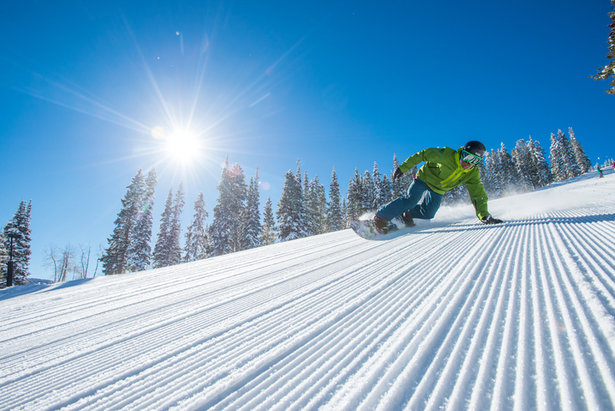 A snowboarder enjoys a groomer at Aspen Highlands. - ©Scott Markewitz Photography, Inc.