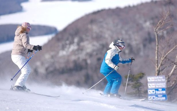 A pair of skiers stretching their legs on the wide slopes of Mt Snow, VT - ©Mt Snow