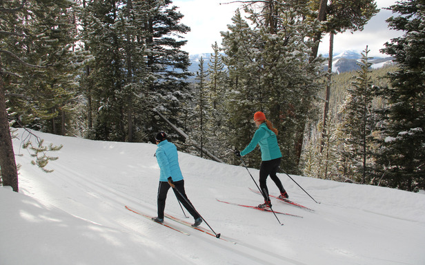 Skiers at Lone Mountain Ranch. Photo by Brian Schott, courtesy of Lone Mountain Ranch.