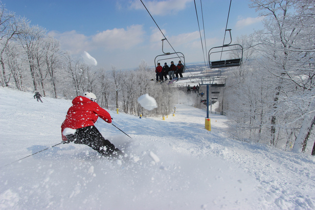 A skier sprays fresh snow under the chairlift. Photo Courtesy of Liberty Mountain.