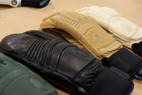 The Hestra Gloves Fall Line Collection features leather cowhide, fiber fill insulation and a neoprene cuff for under the jacket. Its leather is dyed instead of sprayed making it really breathable.