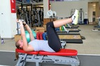 Grete Eliassen demonstrates how she stays healthy as the ski season comes an end with Dumbbell Lat Pullover with Hip Flexion.