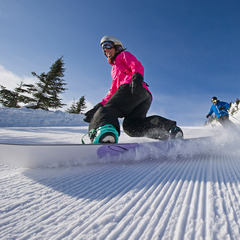 Carving up fresh corduroy under bluebird skies. Photo Courtesy of Smugglers' Notch.
