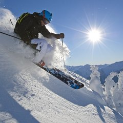 A skier cuts powder at Whistler Blackcomb.