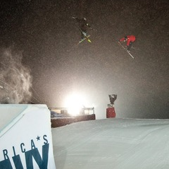 Getting the shot. A competitor is followed over the Big Air jump by a filmer with a GoPro.