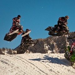 Snocross features up to 15 riders racing for 8 laps over courses of rollers, jumps and berms.