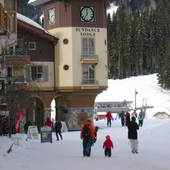 A family walks through the village at Sun Peaks. Photo by Becky Lomax.