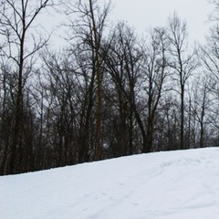 Snowboarding does a backflip at Christie Mountain.