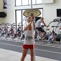 Heather McPhie demonstrates how she stays healthy as the ski season comes an end with Barbell Rotations. - ©OnTheSnow.com