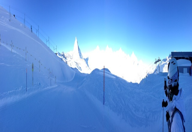 Slopes are empty...plenty of snow...blue skies