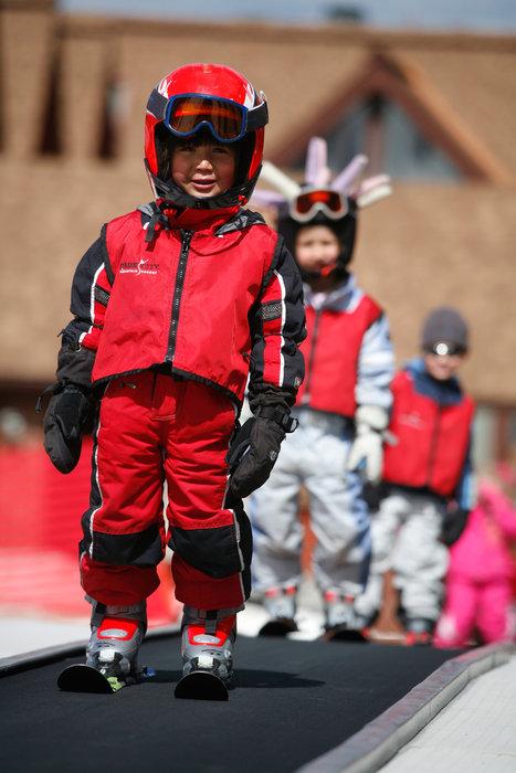 Kids using the magic carpet at Park City Mountain resort, Utah