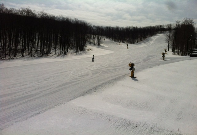 north summit is open and in this pic. no bare spots. slick conditions with a layer of granular powder but still fun.