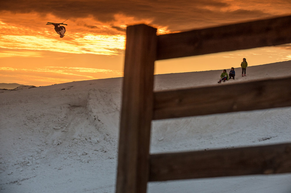 Local chilean kids watch as LJ Strenio enjoys one of La Parva's magical sunsets from a different perpsective. - ©Felix Rioux